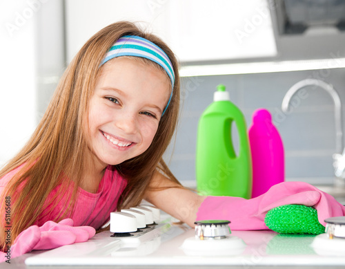 girl make cleaning in the kitchen