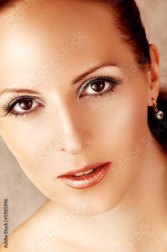 beautiful woman with gerbera flowers