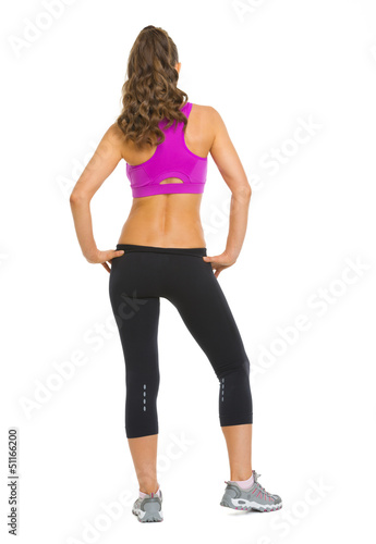 Full length portrait of fitness young woman. rear view