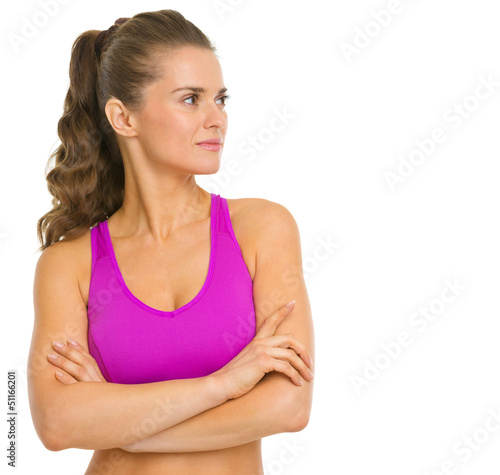 Portrait of fitness young woman looking on copy space