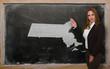 Teacher showing map of massachusetts on blackboard