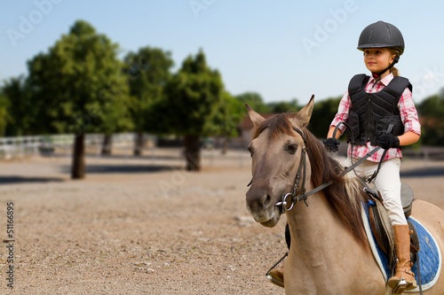Papiers peints Equestre Horse riding - lovely girl is riding on a horse