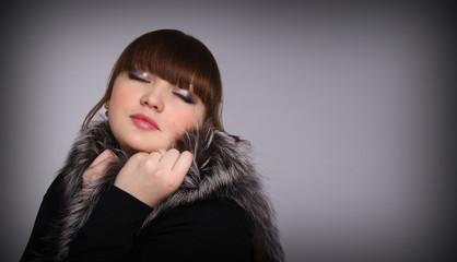 beautiful girl in a fur cape