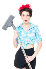 Beautiful young house wife with vacuum cleaner on white