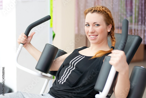 Cute young happy smiling woman doing fitness exercesing