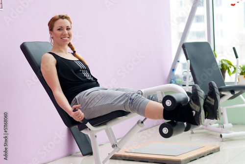 Cute young happy smiling woman going fitness exercesing