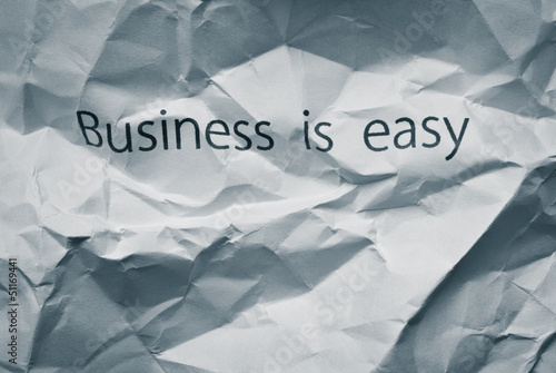 Crumpled paper with words Business is easy