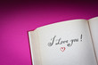 I love you! vintage words in the open book with pink background
