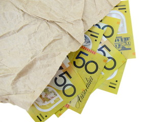 Australian Fifty dollar notes in paper bag