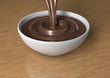 3d render of liquid milk chocolate being poured in a bowl.