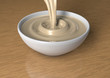 3d render of liquid white chocolate being poured in a bowl.