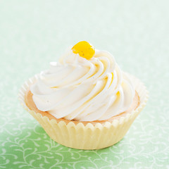 Tartlet with whipped cream, vanilla and jam, selective focus