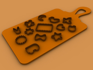 13 molds for baking cookies set on a cutting board