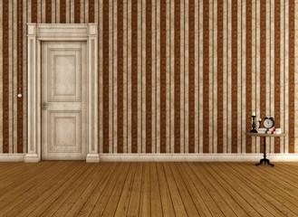 Empty vintage room with dirty classic door