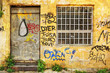 Abandoned shop exterior covered with graffiti in Athens