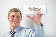 Handsome businessman pressing on follow button