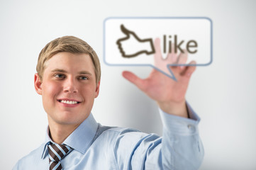 Business man touching social media button with thumb up symbol o