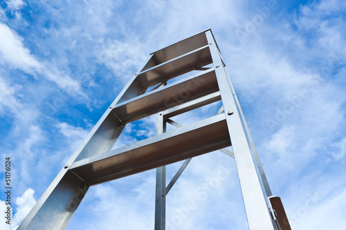 Stainless steel ladder and blue sky