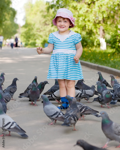 two-year girl with doves