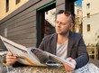 MIddle-aged man reading newspaper