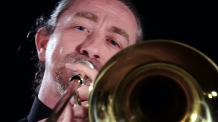 trombone player, close up