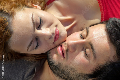 Attractive young couple sleeping