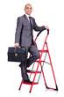 Businessman in career ladder concept