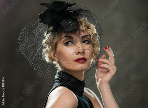 Elegant blond retro woman  wearing little hat