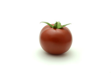 single tomato with green leaves isolated