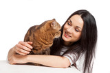 beautiful smiling brunette girl and her ginger cat over white ba