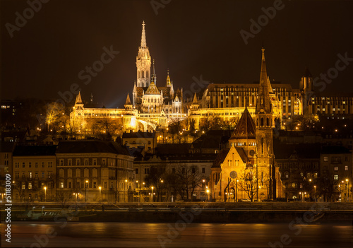 Matthias Church and Protestant church in Budapest at night