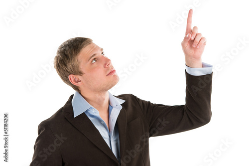 A confident young businessman pointing upwards while isolated on