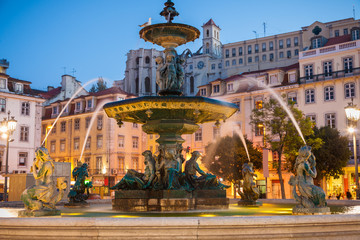 Baroque fountain in Rossio square at dusk, Lisboa, Portugal