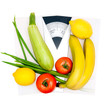 Vegetables and fruits on the scales