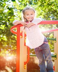little girl on outdoor playground