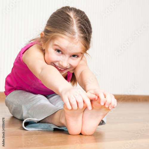 little girl engaged in fitness
