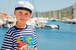 Kid boy standing at a seashore