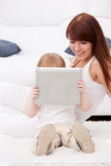 Mother and daughter using a tablet pc