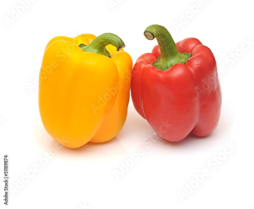 fresh yellow and red bell peppers isolated on white