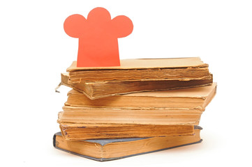 book stack with paper chef hat shape