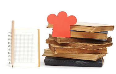 paper shape chef hat on stack books and blank notebook for your