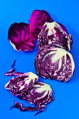 Red cabbages on a blue background.
