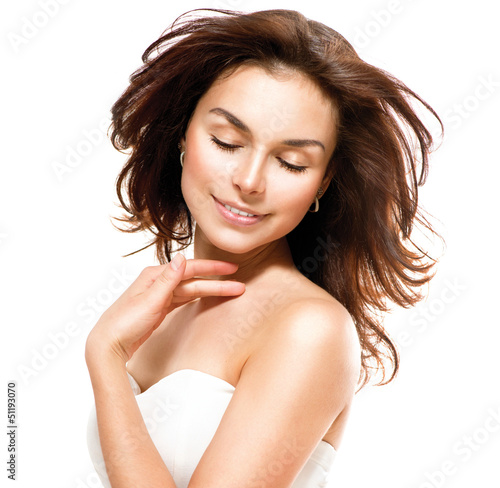 Beautiful Young Woman touching Her Skin. Portrait over White