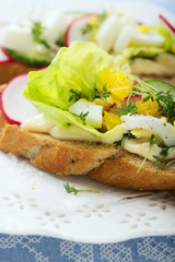 Sandwiches wit egg, lettuce, radish and cucumber