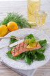 grilled salmon fillets on spinach