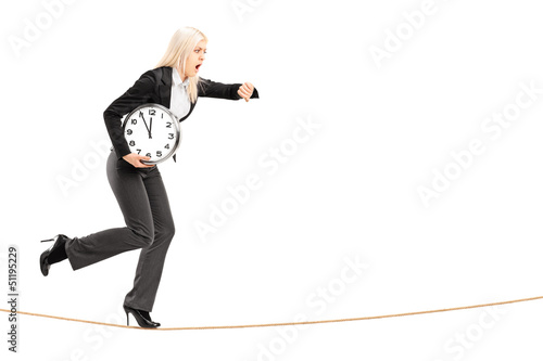 Full length portrait of a young businesswoman running late on a