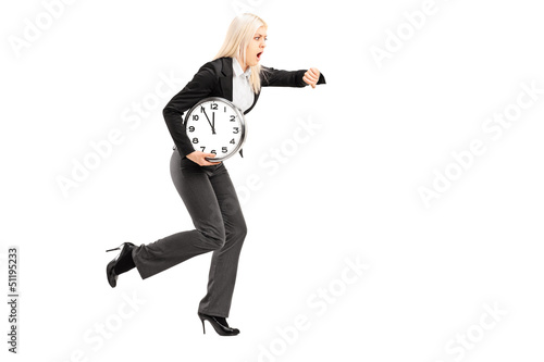 Full length portrait of a young businesswoman running late with
