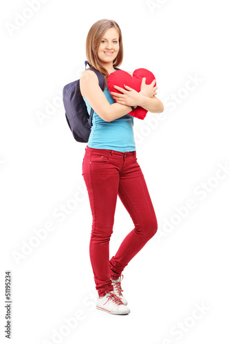Full length potrait of a female student with backpack holding a
