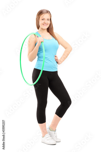Full length potrait of a young female athlete holding a hula-hoo