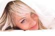 blond girl relaxing in bedroom